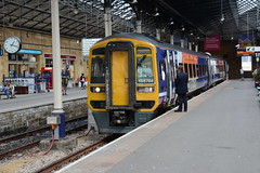 2015-08-17 @ Scarborough: 1J29 1328 Scarborough-Hull-Doncaster-Sheffield: Class 158 158784 52784 57784 [DSC_0893] (graeme9022) Tags: uk roof england clock station rural train coast diesel yorkshire north transport guard platform rail super resort east transportation multiple express local passenger northern eastern regional conductor unit hydraulic sprinter brel