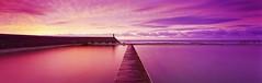 Walk the line (rubberducky_me) Tags: pink panorama reflection film beach water yellow sunrise pier purple jetty australia velvia baths nsw fujifilm linhof newcaste newcastlebaths oceanbaths linhoftechnorama617iiis