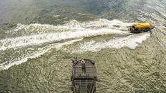 Watertaxi rushes by. (PvRFotografie) Tags: water speed river boot boat rotterdam ship wide wideangle watertaxi schip rivier snelheid varen rotterdamzuid rotterdamcharlois sony16mmf28fisheye sonyslta99