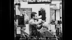 wee trim after dark (byronv2) Tags: edinburgh edimbourg scotland edinburghbynight night nuit nacht oldtown window peoplewatching man street candid barber hairdresser shop barbersshop haircut blackandwhite blackwhite bw monochrome
