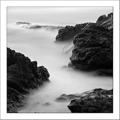 Rocks at Stazzo (Les Cornwell Photos) Tags: longexposure 10stopper stazzo rocks water sicily italy seascape sea blackandwhite coast waves