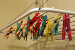 Clothespin on a Rack (skron) Tags: clothespins laundry color