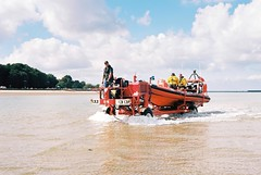 Ryde Inshore Rescue - Return to Shore (Chi Bellami) Tags: sea rescue colour film beach 35mm coast sand nikon kodak scan negative shore scanned 100 rib ryde nikonos ektar c41 appley inshore nikonosv scalefocus amphibiouscamera zonefocus rydeinshorerescue chibellami photohippo