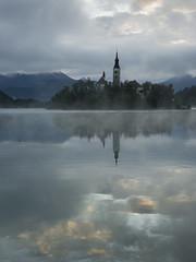 Lake Bled (DaveH101) Tags: blue cloud lake reflection church dawn cool slovenia bled assumption