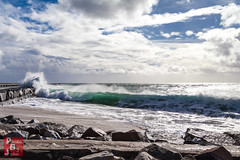The Curl (*PhotoByJohn*) Tags: 5d 5dmkii beach california losangeles other sanpedro blue breakingwave breakwater cabrillobeach canon5dmkii clouds curl nature ocean pacificocean photobyjohn rocks sea sky wave