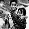 -c20161125_810_2542_-157-158 (Erik Christensen242) Tags: đắkkrông kontum vietnam vn siblings boy girl carrying bw monochrome babysitter smile