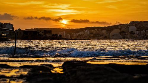 Sunset wave at St Pauls Bay