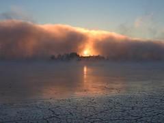 Fire and ice with a foggy cloak (KaarinaT) Tags: sunrise fog seafog dawn sun morning sea water ice mist crackedice helsinki finland kaivopuisto