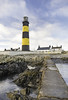 St. John's Point Lighthouse (Stephen_Lavery) Tags: lighthouse beacon sentinel flash black yellow striped stephenlavery wall sea shore coastal watch