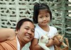 quit screwing around mom, this is supposed to be a photo of me (the foreign photographer - ฝรั่งถ่) Tags: mother daughter two kittens khlong thanon portraits bangkhen bangkok thailand canon kiss child girl