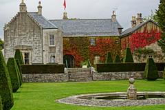 Pitmedden House. (artanglerPD) Tags: autumn red house green colours flag pitmedden