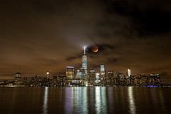 Thank Goodness for a Break in the Clouds (saebaryo) Tags: nyc moon composite canon eclipse blood jerseycity nightscape manhattan worldtradecenter harvest super wtc lunar bloodmoon 2470mm canon2470mmf28l supermoon canoneos5dmarkiii 5d3 5diii