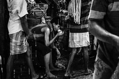 A brief moment...Mumbai. (Presence Inc) Tags: crowds portrait market people rx100m3 shadows compact candid india everyday bw rain community cinematic street sony city mirrorless rx100 texture lowlight streetphotography contrast urban still stilllife dark photography life layers society photograph citylife jobs mumbai
