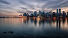 Hallelujah Point Sunset (Sworldguy) Tags: vancouver vancouverharbour hallelujahpoint sunset skyline skyscape longexposure milky clouds stanleypark tourism britishcolumbia waterfront downtown multicolour wideangle scenic port canadaplace reflections sails shoreline cityscape citylights d7000 dslr pano buildings
