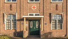 Hospital (Jorden Esser) Tags: s 1930 assen wilhelminaziekenhuis ddd drentsmuseum entrance facade gablestones greendoor hospital redcross thursdaydoorday windows