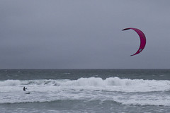 Riding the Nor'Easter (brucetopher) Tags: kite surf kitesurfing wind water waves people man woman surfer speed fast windy strong gusty wave ocean sea sport watersports saltwater atlantic newengland grey cloudy winter cold blustery green break air weather beach