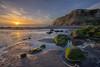 Velvet cushions (zebedee1971) Tags: river sea sunset sun sunlight light rocks moss green velvet fresh waves sand hills cliffs clouds cloudy sky rays