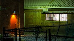 Back Alley (PhoenixRoofing164) Tags: red reflections street reflection night lights fence shadows alley long exposure roofing spooky fences stylized photography color correction back crime scene door green tint seedy