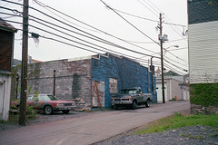 (patrickjoust) Tags: ashland pennsylvania schuylkillcounty truck car alley house fujicagw690 kodakportra400 120 6x9 medium format c41 color negative film manual focus analog mechanical patrick joust patrickjoust coal region country schuylkill county pa usa us united states north america estados unidos autaut small town old auto automobile vehicle parked
