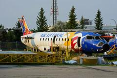 ex Air Littoral CRJ-100 parting out@YYC (Steelhead 2010) Tags: yyc crj canadair freg airlittoral crj100 fgptk fgptm fgptj