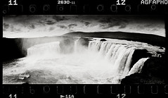 . (tsiklonaut) Tags: travel sky bw panorama white black fall film blanco water contrast analog 35mm river landscape island waterfall iceland y drum scanner pano horizon negro wide dramatic surreal panoramic scan experience 400 roll analogue 135 agfa foss apx 202 analogica contrasty discover icelandic drumscan ufg analoog pmt goðafoss panoraam maastik goða ethol photomultipliertube