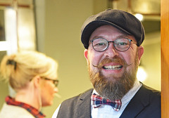 Welcome to my Emporium. (MWBee) Tags: lymm cheshire barbershop hat glasses shop hairdressers beard smile mwbee nikon d750 dickiebow