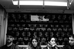Attese (Gianluca De Simone) Tags: berlin bahn s metropolitan station metro train treno stazione berliner woman boy tired bored stanco annoiato noia boredom fatigue waiting black white street photography high contrast vetro glass brandeburg tor sleeping dormendo dormire sleep