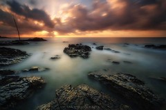 Spe vitae (Blai Figueras) Tags: sky agua seascape water horizon landscape amanecer atmosphere coast seaside panorama longexposure stones sun le paraiso rocas eden sea beach paisaje paradise flickr playa costadelsol costa cielo mar clouds rocks silkeffect wow