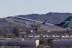 WestJet's 100th Boeing 737 NG C-GAWS-3719 (rob-the-org) Tags: kphx phx skyharborinternational phoenixaz westjet boeing 737 737ng 737800 cgaws 100boeing737ng f11 190mm 1320sec iso100 cropped noflash