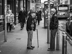 The Meeting (Leanne Boulton) Tags: monochrome people urban street candid portrait streetphotography candidstreetphotography streetlife man men old age elderly face faces facial expression posture gesture standing talking interaction friendship personalspace sociallandscape tone texture detail depthoffield naturallight outdoor light shade city scene human life living humanity society culture canon canon5d 5dmkiii 70mm character ef2470mmf28liiusm black white blackwhite bw mono blackandwhite glasgow scotland uk