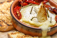 Macro Mondays – Say Cheese! (Kev Gregory (General)) Tags: macromondays saycheese tomato italian french continental pushed boat out week think terracotta dish stoneware baker traditional président camembert preseident soft ripened cheese bloomy rind creamy core normandy france sundried tomatoes rosemary decoration flavour cooking ciabatte bread drizzled olive oil pan seared griddle ruin effect image dunking toast delightful melted run runny baked oven toasted brown crumbs tasty consumed kev gregory canon 7d macro mondays 100 100mm f28 usm ef challenge theme brie savory