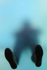 Through A Glass Darkly No. 7 (lawroberts) Tags: new york city nyc urban ny abstract man topf25 glass silhouette 1025fav photoshop manhattan 100v10f 200v straightflush nikonstunninggallery flickrjobdiff potwkkc26 superhearts vanagram