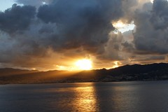 Storm brewing over Sicily (tollen) Tags: sunset italy sun storm black clouds gold sicily