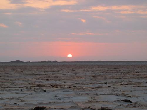 Sun rising over the salt