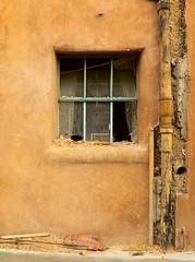 Broken Window (karefreeartist) Tags: newmexico santafe broken window glass 1025fav decay 100v10f loveit adobe utata stucco interestingness80 i500 newphotographer cotcmostfavorites abigfave 0xbc8c54