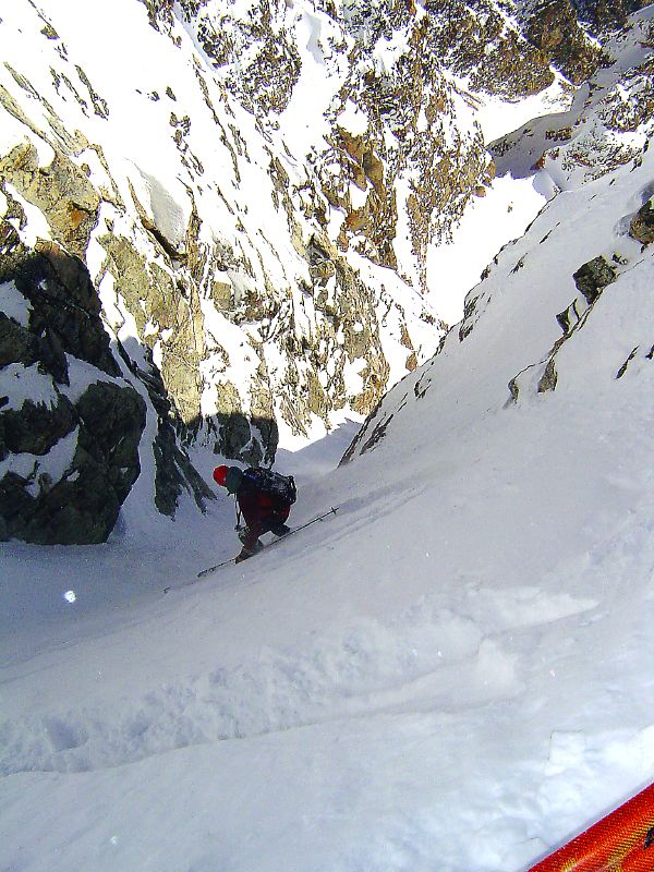 Skiing through the crux of the Southeast Couloir on the South Teton