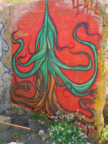 graffiti from Pacifica, CA: a flowing green tree, over flowing brown roots