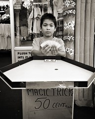 Magic Trick - 50 cents (hodge) Tags: people bw d50 cards niagarafalls performers magictrick