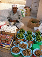 Old Omani at Souq in Muscat (tofugalaxy) Tags: mountains buildings palms temple persian desert market muslim middleeast mosque palmtrees oasis arab dates oman fortress portuguese wadi muscat souq suq omani musquat halua