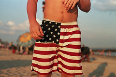 O say, can you see..... (lomokev) Tags: blue red white newyork beach brooklyn america canon stars coneyisland 50mm sand dof flag depthoffield patriot agfa redwhiteandblue ultra strips starsandstripes lag agfaultra eos1 amrica  deletetag canoneos1 amreeca publishedinjpg submittedtojpg rota:type=showall rota:type=portraits use:on=moo file:name=eos10806c24