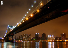 Manhattan light (Rich007) Tags: nyc newyorkcity bridge light usa ny newyork reflection water brooklyn night 1025fav america skyscraper river dark lights evening skyscrapers manhattan pair manhattanbridge getty northamerica hudsonriver hudson gettyimages 2pair p1f1 enlightenedbridge