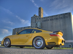 Porsche 911 Turbo (kevbo1983) Tags: toronto ontario canada yellow 911 cement multipleexposure turbo porsche harbourfront hdr queensquay grainsilos photomatix porsche911turbo canadamaltingcolimited kevbo1983  worldcars