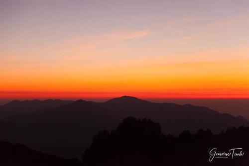 The sun rises over Kelimutu National Park, near Moni, Flores, Indonesia (August 2015)