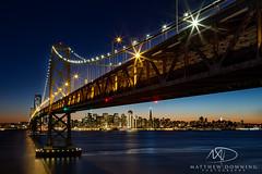 Oakland Bay at Night (www.matthewdowningphotography.com) Tags: sanfrancisco california city bridge usa water night america lights unitedstates sanfran oaklandbaybridge oakbaybridge