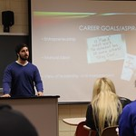A student explaining his career goals and aspirations to fellow students in his class during a presentation.