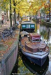 Kloveniersburgwal, Amsterdam, The Netherlands (PhotosToArtByMike) Tags: kloveniersburgwal amsterdam netherlands boats canalboat oldcentre dutch holland centrum centrecity medieval canal nieuwmarkt amstelriver