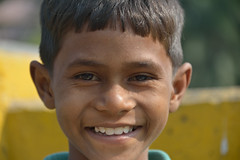 The priceless smile (sanat_das) Tags: 28300mm d800 portrait boy smile street urchin santoshpur kolkata