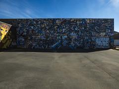 In the Spotlight (Steve Taylor (Photography)) Tags: art cartoon graffiti mural streetart wall strange girl child newzealand nz southisland canterbury christchurch shadow sunny sunshine