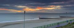Hover Kids (nicklucas2) Tags: sunset seascape beach sea sand groyne cloud streetlight segway seaside