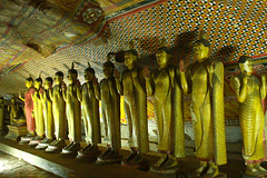 Golden Buddha Statues in Dambulla Cave Temple (Chandana Witharanage) Tags: srilanka ancient architecture asia asian attraction buddha buddhism cave closeup colour colourful culture dambulla detail east famous feet foot gold golden historic history island landmark lanka large meditation monastery mount mural old painting peace place praying religion rock sacred spirituality standing statue stone temple tourism traditional travel worship chandanawitharanagephotography